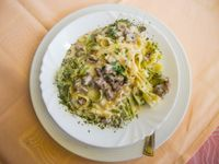 Lasagnette con pancetta rosolata e broccolo fritto